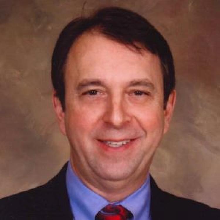Dr.  Bradley Stoner