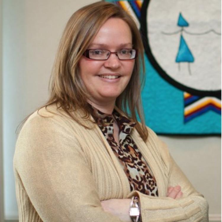 Dr.  Heather Castleden